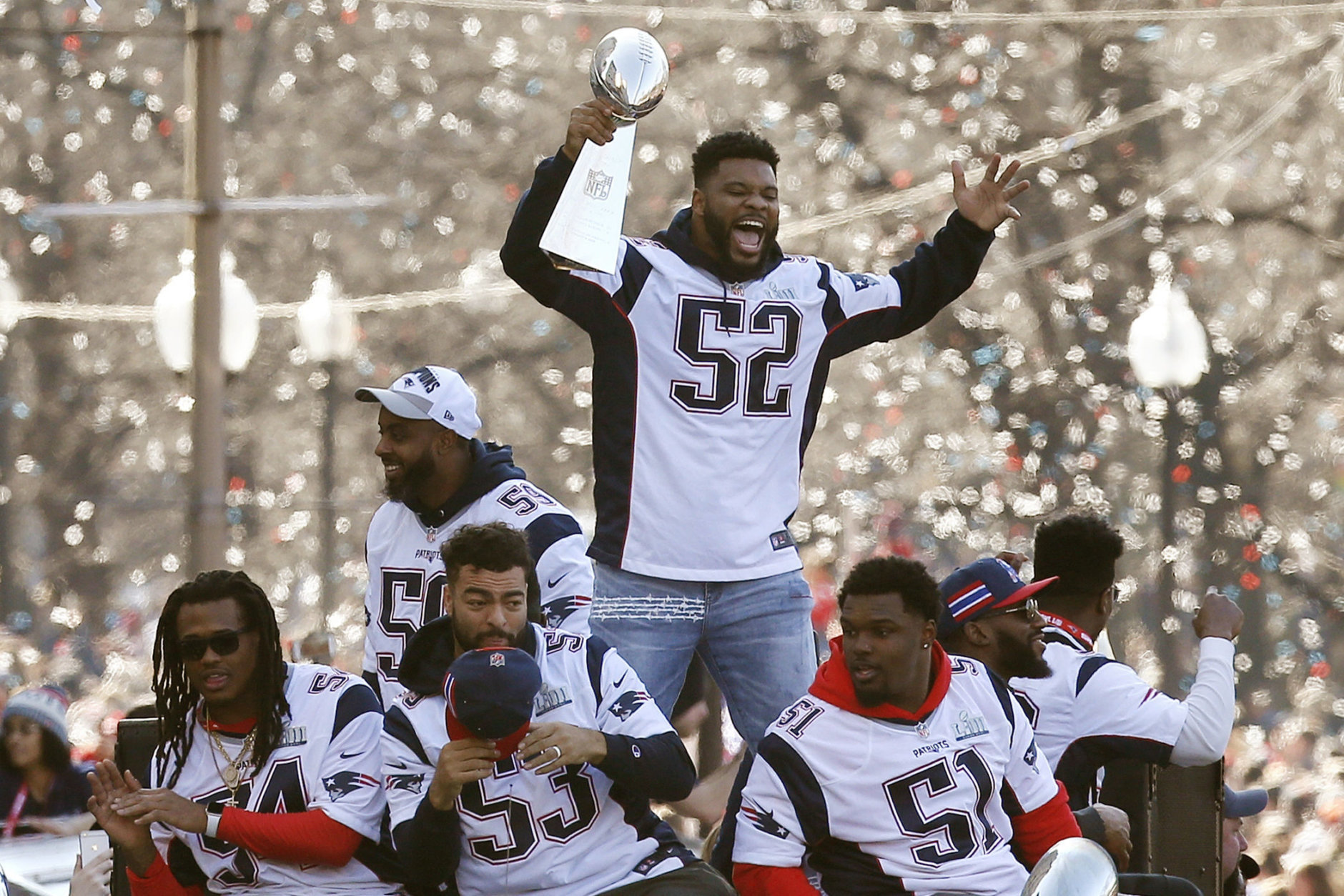 New England Patriots' Elandon Roberts (52) rides a duck boat during the Patriots parade through downtown Boston, Tuesday, Feb. 5, 2019, to celebrate their win over the Los Angeles Rams in Sunday's NFL Super Bowl 53 football game in Atlanta. (AP Photo/Michael Dwyer)