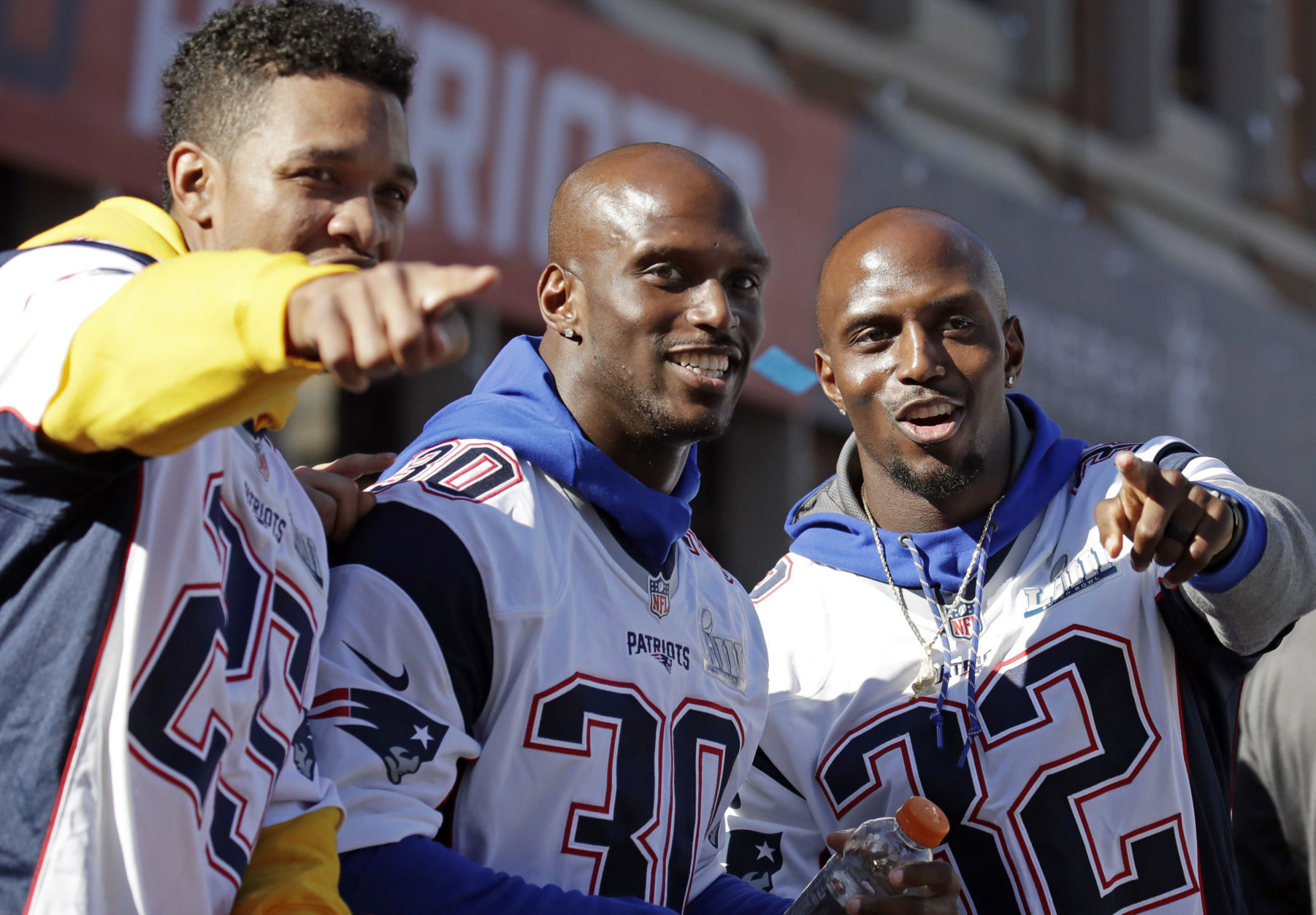 New England Patriots (l-r) Eric Rowe, Jason McCourty and Devin McCourty react to fans during their victory parade through downtown Boston, Tuesday, Feb. 5, 2019, to celebrate their win over the Los Angeles Rams in Sunday's NFL Super Bowl 53 football game in Atlanta. The Patriots have won six Super Bowl championships. (AP Photo/Elise Amendola)