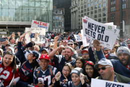 Fans cheer during the New England Patriots victory parade in downtown Boston, Tuesday, Feb. 5, 2019, to celebrate their win over the Los Angeles Rams in Sunday's NFL Super Bowl 53 football game in Atlanta. The Patriots have won six Super Bowl championships. (AP Photo/Elise Amendola)