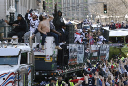 New England Patriots' Trent Brown, left, and Joe Thuney, center, sit beside David Andrews as he chugs a beverage during the team's parade through downtown Boston, Tuesday, Feb. 5, 2019, to celebrate their win over the Los Angeles Rams in Sunday's NFL Super Bowl 53 football game in Atlanta. (AP Photo/Michael Dwyer)