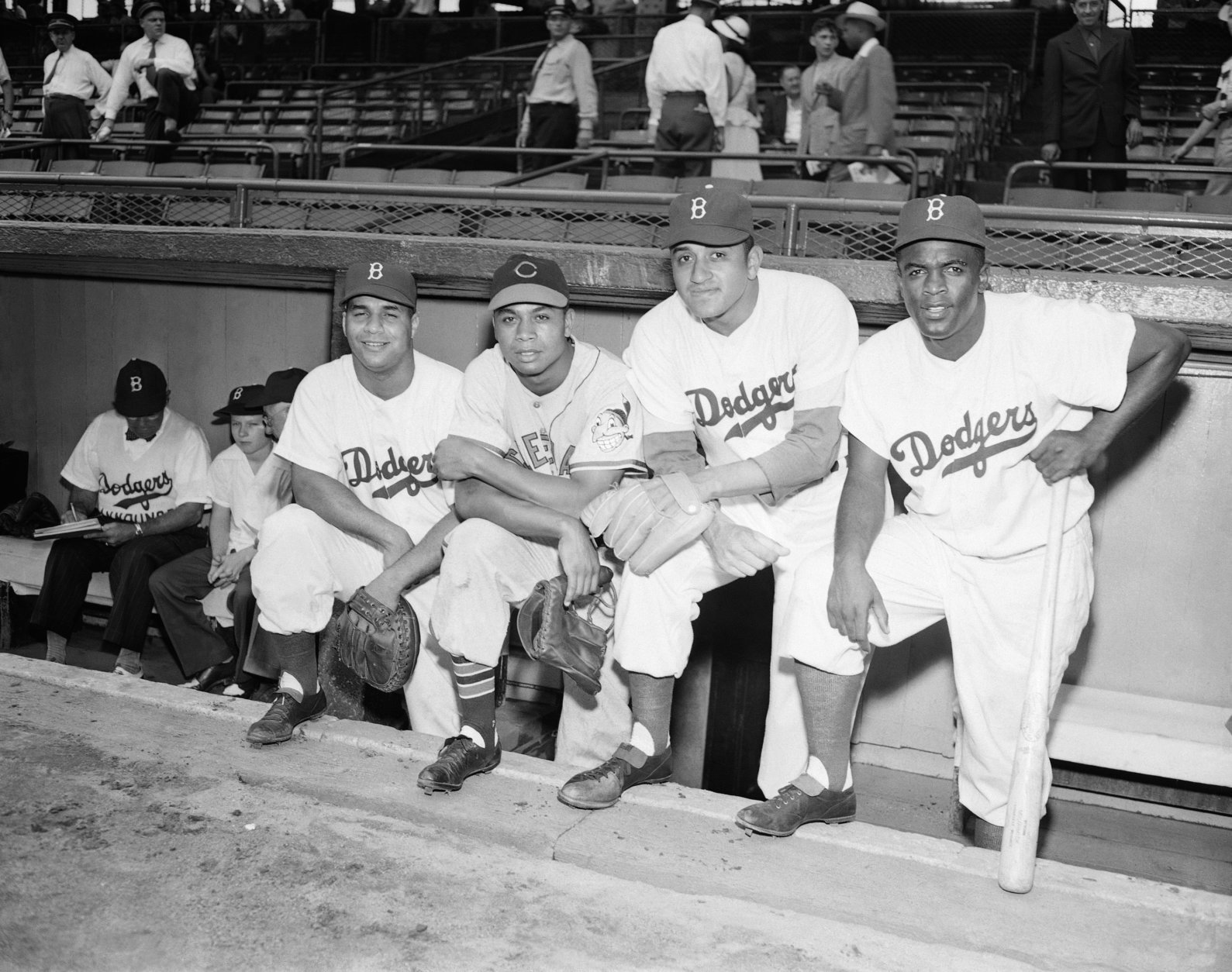 FILE - From left, in a July 12, 1949, file photo, Roy Campanella, Larry Doby, Don Newcombe and Jackie Robinson pose at the 16th annual All-Star Game at Ebbetts Field in Brooklyn, New York. Newcombe, the hard-throwing Brooklyn Dodgers pitcher who was one of the first black players in the major leagues and who went on to win the rookie of the year, Most Valuable Player and Cy Young awards, has died. He was 92. The team confirmed that Newcombe died Tuesday morning, Feb. 19, 2019, after a lengthy illness. (AP Photo/File)