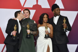 """Rami Malek, left, winner of the award for best performance by an actor in a leading role for """"Bohemian Rhapsody"""", kisses Olivia Colman, winner of the award for best performance by an actress in a leading role for """"The Favourite"""", as they appear with Regina King, winner of the award for best performance by an actress in a supporting role for """"If Beale Street Could Talk"""", and Mahershala Ali, winner of the award for best performance by an actor in a supporting role for """"Green Book"""", right, in the press room at the Oscars on Sunday, Feb. 24, 2019, at the Dolby Theatre in Los Angeles. (Photo by Jordan Strauss/Invision/AP)"""