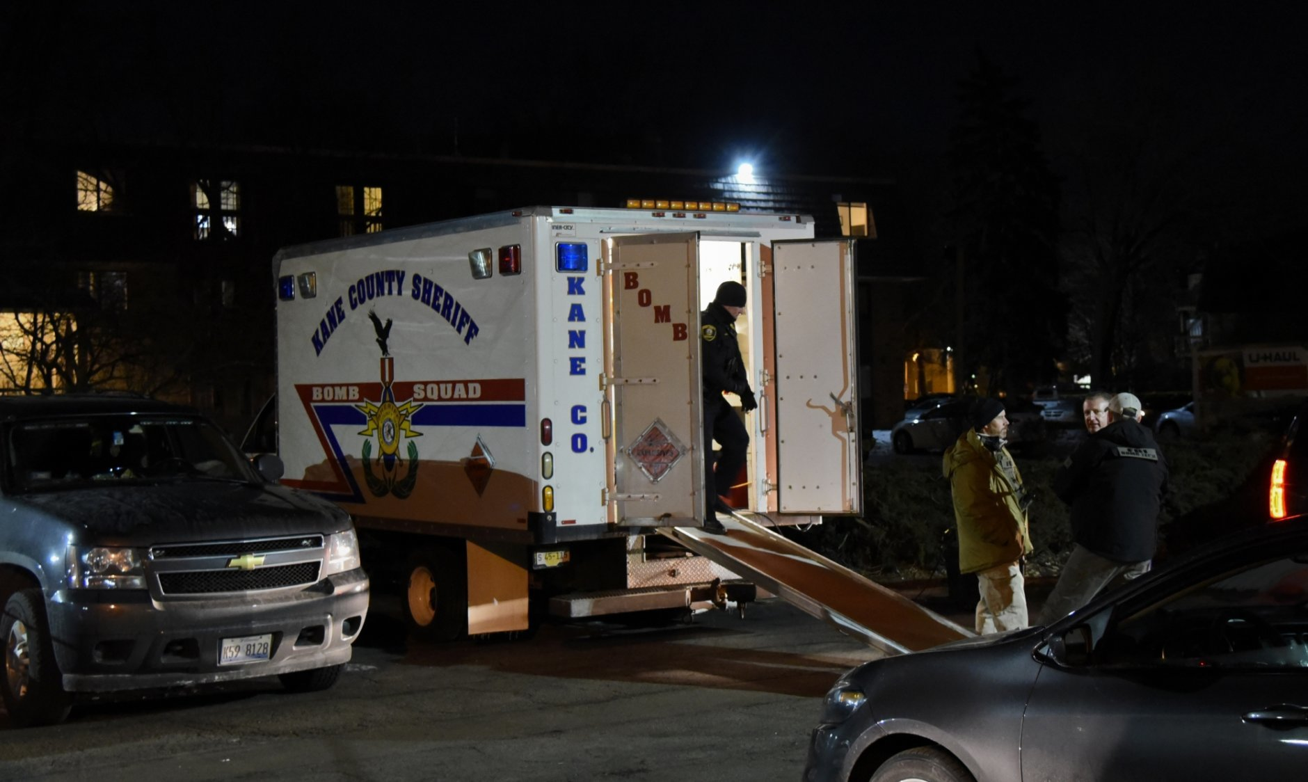 Investigators work at the apartment complex of the alleged shooter from the Henry Pratt Co. on Friday, Feb. 15, 2019, in Aurora, Ill. An employee of a manufacturing company opened fire in its suburban Chicago plant Friday, killing several people and wounding several police officers before he was fatally shot, police said. (AP Photo/Matt Marton)