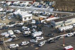 First responders and emergency vehicles are gathered near the scene of a shooting at an industrial park in Aurora, Ill., on Friday, Feb. 15, 2019. (Bev Horne/Daily Herald via AP)