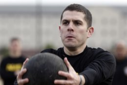 In this Jan. 8, 2019, photo, Army Capt. Aaron Lopez participates in a ball-toss drill while preparing to be an instructor in the new Army combat fitness test at Fort Bragg, N.C. The new test is designed to be a more accurate test of combat readiness than the current requirements. (AP Photo/Gerry Broome)