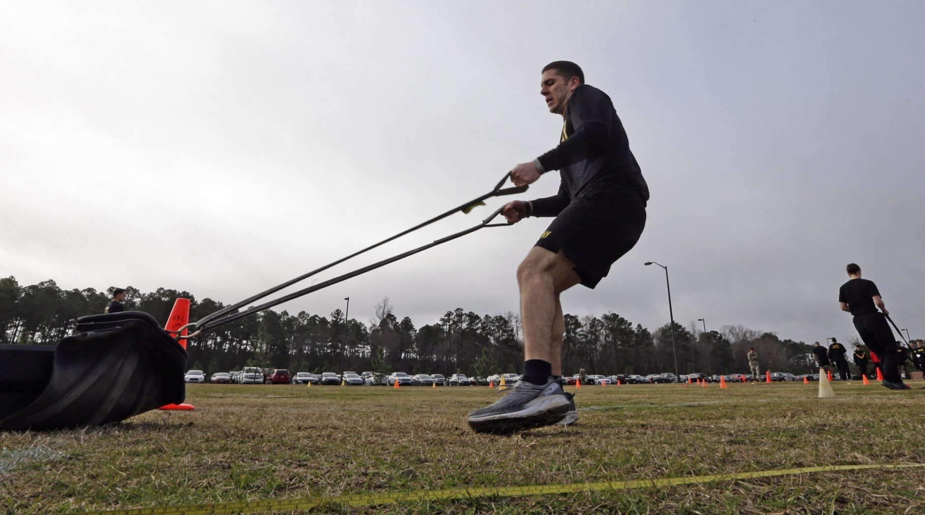 In this Jan. 8, 2019, photo, U.S Army Capt. Aaron Lopez participates while preparing to be an instructor in the new Army combat fitness test at Fort Bragg, N.C. The new test is designed to be a more accurate test of combat readiness than the current requirements. (AP Photo/Gerry Broome)