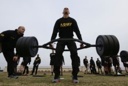 In this Jan. 8, 2019, photo, U.S Army 1st Lt. Mitchel Hess participates in a weight lifting drill while preparing to be an instructor in the new Army combat fitness test at Fort Bragg, N.C. The new test is designed to be a more accurate test of combat readiness than the current requirements. (AP Photo/Gerry Broome)