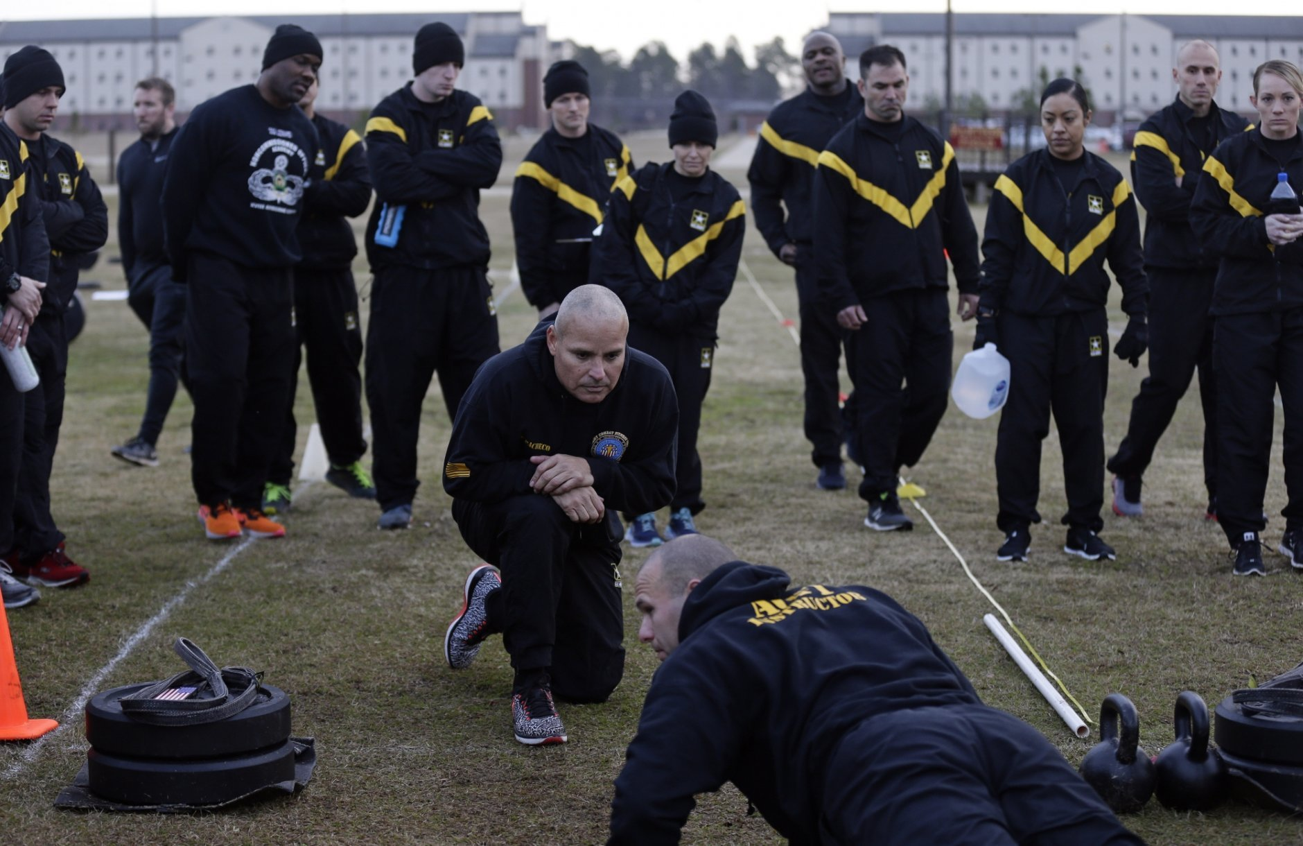 In this Jan. 8, 2019, photo, U.S Army troops observe as instructors demonstrate requirements in the new Army combat fitness test at the 108th Air Defense Artillery Brigade compound at Fort Bragg, N.C. The new test is designed to be a more accurate test of combat readiness than the current requirements. (AP Photo/Gerry Broome)