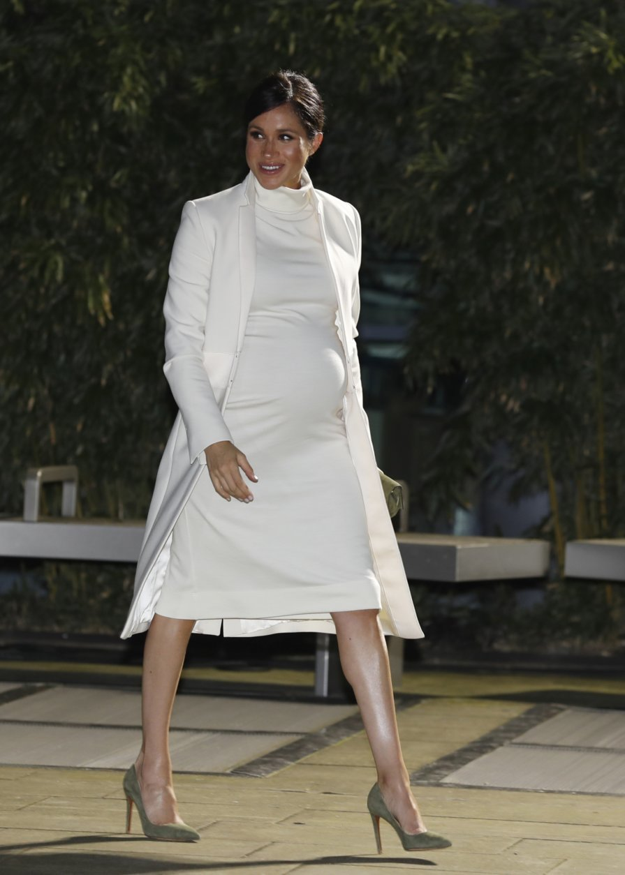 FILE - In this Tuesday, Feb. 12, 2019 file photo, Meghan, Duchess of Sussex arrives for a charity event at the Natural History museum in London. Nine months after her globally televised wedding extravaganza, the 37-year-old woman now formally known as the Duchess of Sussex is finding that life in the royal fishbowl carries not just glamour and great charitable opportunities but liabilities as well. (AP Photo/Alastair Grant, file)