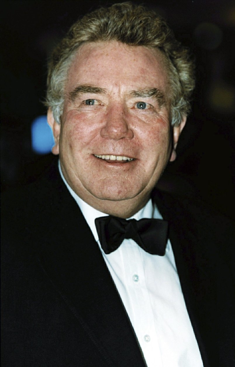 """FILE - In this Feb. 25, 2001 file photo, actor Albert Finney, poses for a photo. British Actor Albert Finney, the Academy Award-nominated star of films from """"Tom Jones"""" to """"Skyfall"""" has died at the age of 82 it was reported on Friday, Feb. 8, 2019. (William Conran/PA via AP, FIle)"""