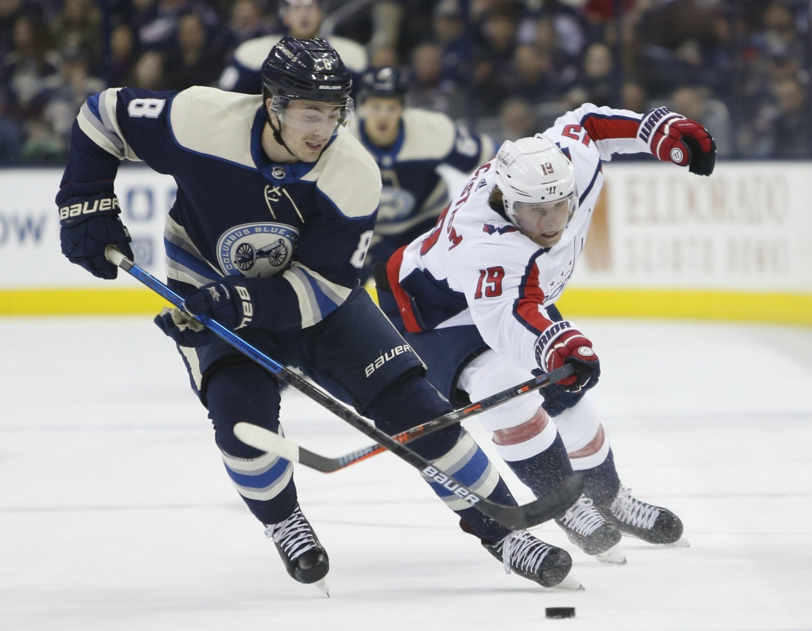 Columbus Blue Jackets' Zach Werenski, left, tries to control the puck as Washington Capitals' Nicklas Backstrom, of Sweden, defends during the first period of an NHL hockey game Tuesday, Feb. 12, 2019, in Columbus, Ohio. (AP Photo/Jay LaPrete)