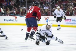 Los Angeles Kings center Michael Amadio (10) falls as Washington Capitals defenseman Brooks Orpik (44) moves the puck during the first period of an NHL hockey game against the Los Angeles, Monday, Feb. 11, 2019, in Washington. (AP Photo/Al Drago)