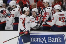 Washington Capitals' T.J. Oshie (77) is congratulated after scoring a goal against the San Jose Sharks in the first period of an NHL hockey game Thursday, Feb. 14, 2019, in San Jose, Calif. (AP Photo/Ben Margot)