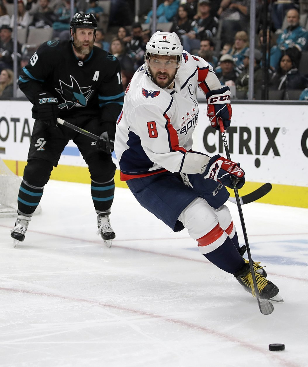 Washington Capitals' Alex Ovechkin (8) moves the puck past San Jose Sharks' Joe Thornton, left, during the second period of an NHL hockey game Thursday, Feb. 14, 2019, in San Jose, Calif. (AP Photo/Ben Margot)