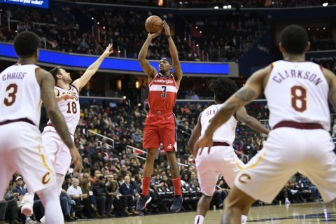 New-look Wizards cruise by Cavaliers in 1st game since trade deadline