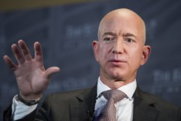 FILE - In this Sept. 13, 2018, file photo, Jeff Bezos, Amazon founder and CEO, speaks at The Economic Club of Washington's Milestone Celebration in Washington. A rich list by wealth compiler Hurun Report shows the market meltdowns in 2018 obliterated $1 trillion in wealth, with more than 212 of China's richest individuals losing their dollar billionaire status. Amazon founder Jeff Bezos led the world's wealthiest for the second year running, estimated by the Hurun Global rich list at $147 billion. (AP Photo/Cliff Owen, File)