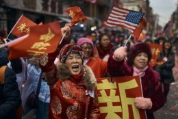 Revelers march and shout to the crowd during the Chinese Lunar New Year parade in Chinatown in New York, Sunday, Feb. 17, 2019. (AP Photo/Andres Kudacki)