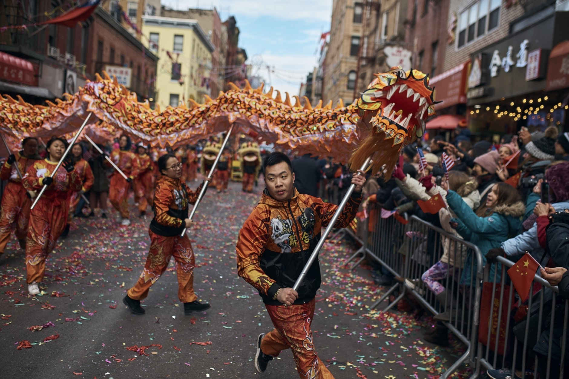 A member of a dragon dance group carries the head of the dragon during the Chinese Lunar New Year parade in Chinatown in New York, Sunday, Feb. 17, 2019. (AP Photo/Andres Kudacki)