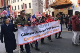 Parade marchers remember Chinese American Veterans who served in World War II. (WTOP/Liz Anderson)