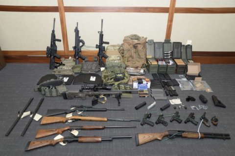 Coast Guard officer accused of making 'hit list' pleads not guilty to drug, gun charges