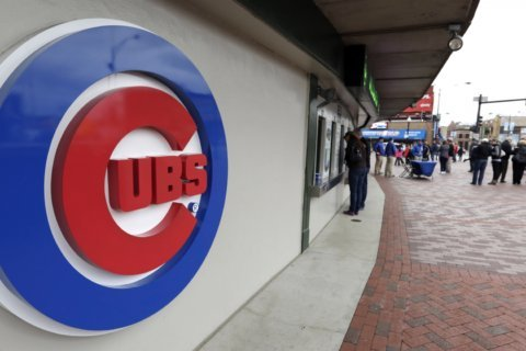 Chicago Cubs ban a fan who was seen making a white power gesture behind a black reporter