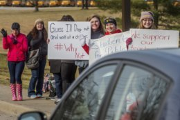 From right, Hurricane High school students Amanda Bird, Natalie Reger and Olivia Burns demonstrate with others outside of Hurricane High School in Putnam County, W.Va, during the first day of a statewide strike by teachers and school personnel on Tuesday, Feb. 19, 2019. (Craig Hudson/Charleston Gazette-Mail via AP)