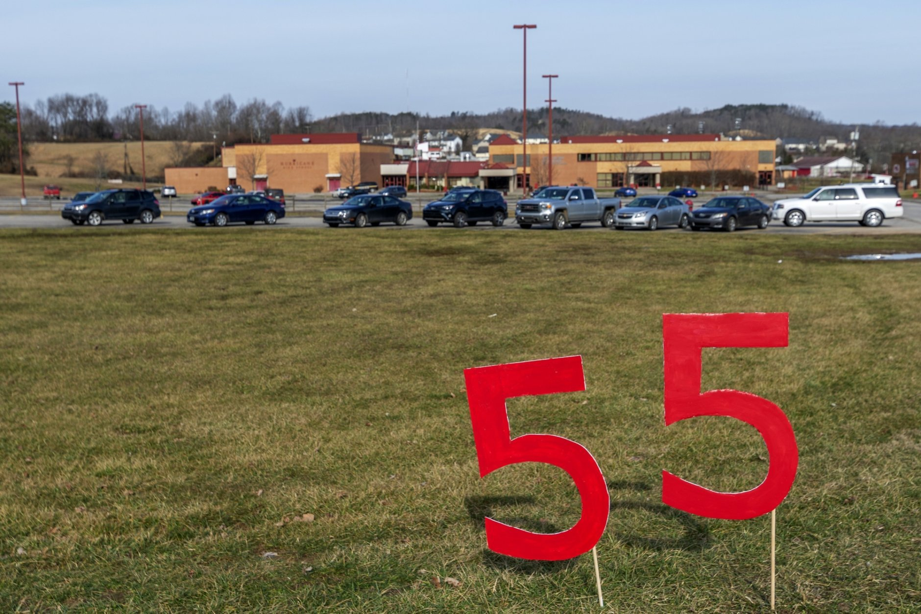 A 55 United sign stands outside of Hurricane High School which remains open in Putnam County, W.Va, during the first day of a statewide strike by teachers and school personnel on Tuesday, Feb. 19, 2019. While the other 54 state counties have decided to close schools, Putnam county has decided to keep its schools open. (Craig Hudson/Charleston Gazette-Mail via AP)
