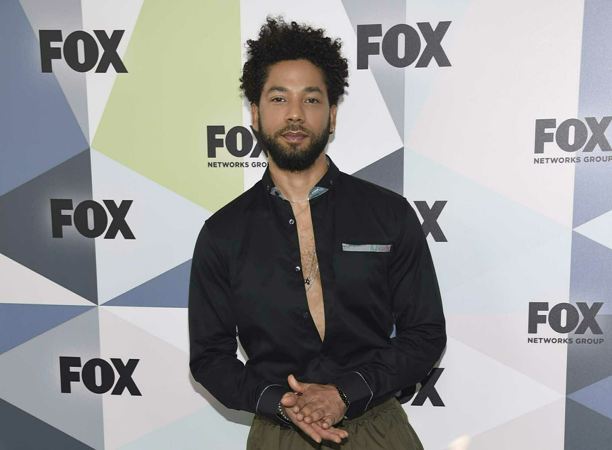 The Latest: 'Empire' actor turns self in to face charge