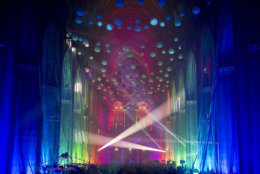 """Adults gathered Thursday night inside a colorfully lit cathedral for a """"Second Chance Prom."""" (Courtesy Washington National Cathedral)"""