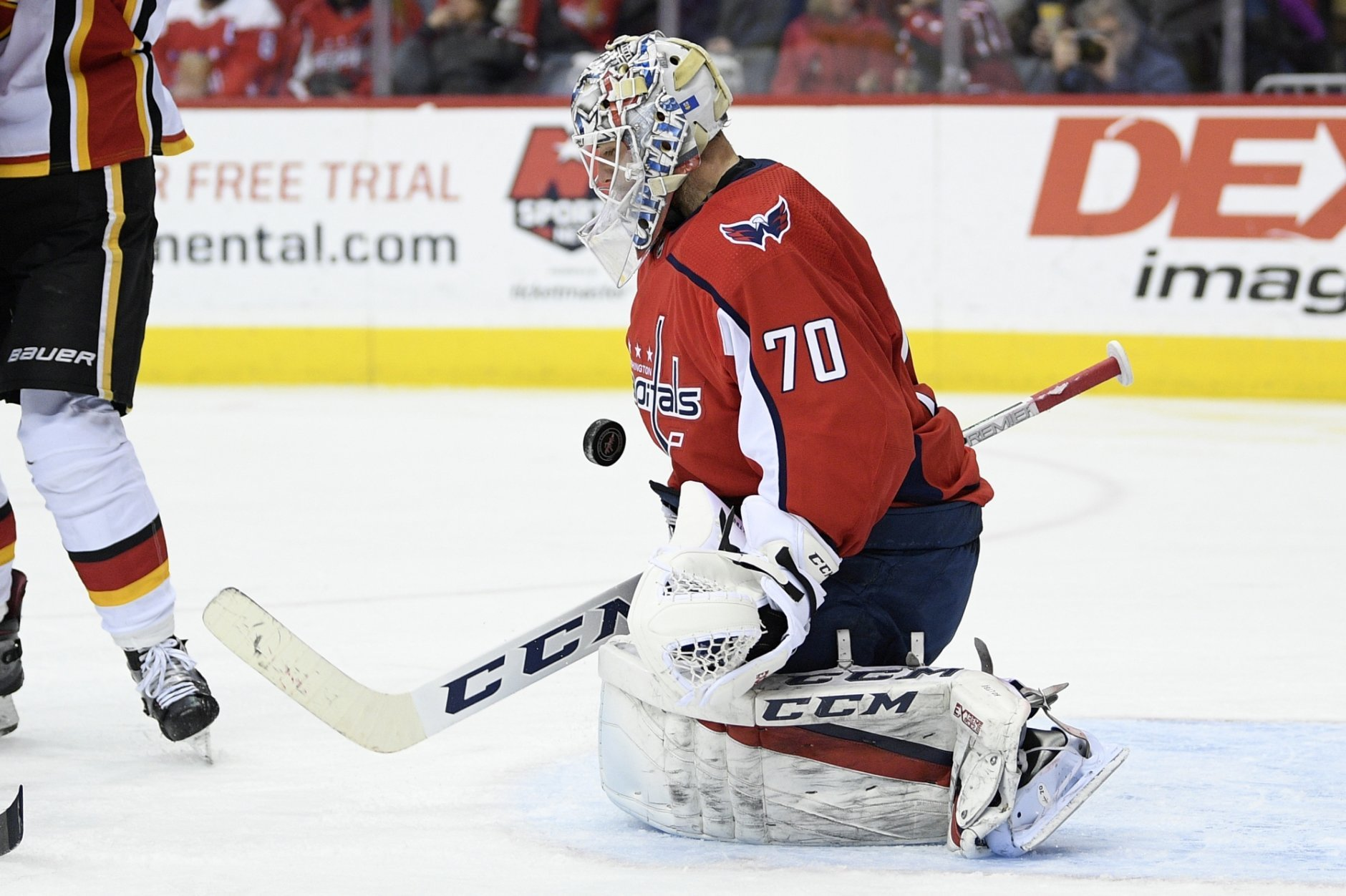 Washington Capitals goaltender Braden Holtby (70) stops the puck during the second period of an NHL hockey game against the Calgary Flames, Friday, Feb. 1, 2019, in Washington. (AP Photo/Nick Wass)