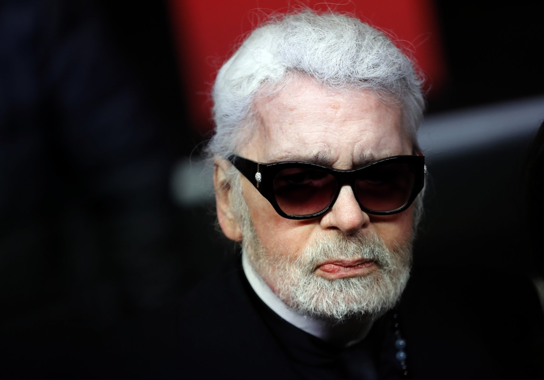 FILE - In this Thursday, Nov. 22, 2018 file photo, Fashion designer Karl Lagerfeld poses during the Champs Elysee Avenue illumination ceremony for the Christmas season, in Paris. Chanel says Tuesday, Feb. 19, 2019 its iconic couturier Karl Lagerfeld has died. (AP Photo/Christophe Ena, File)