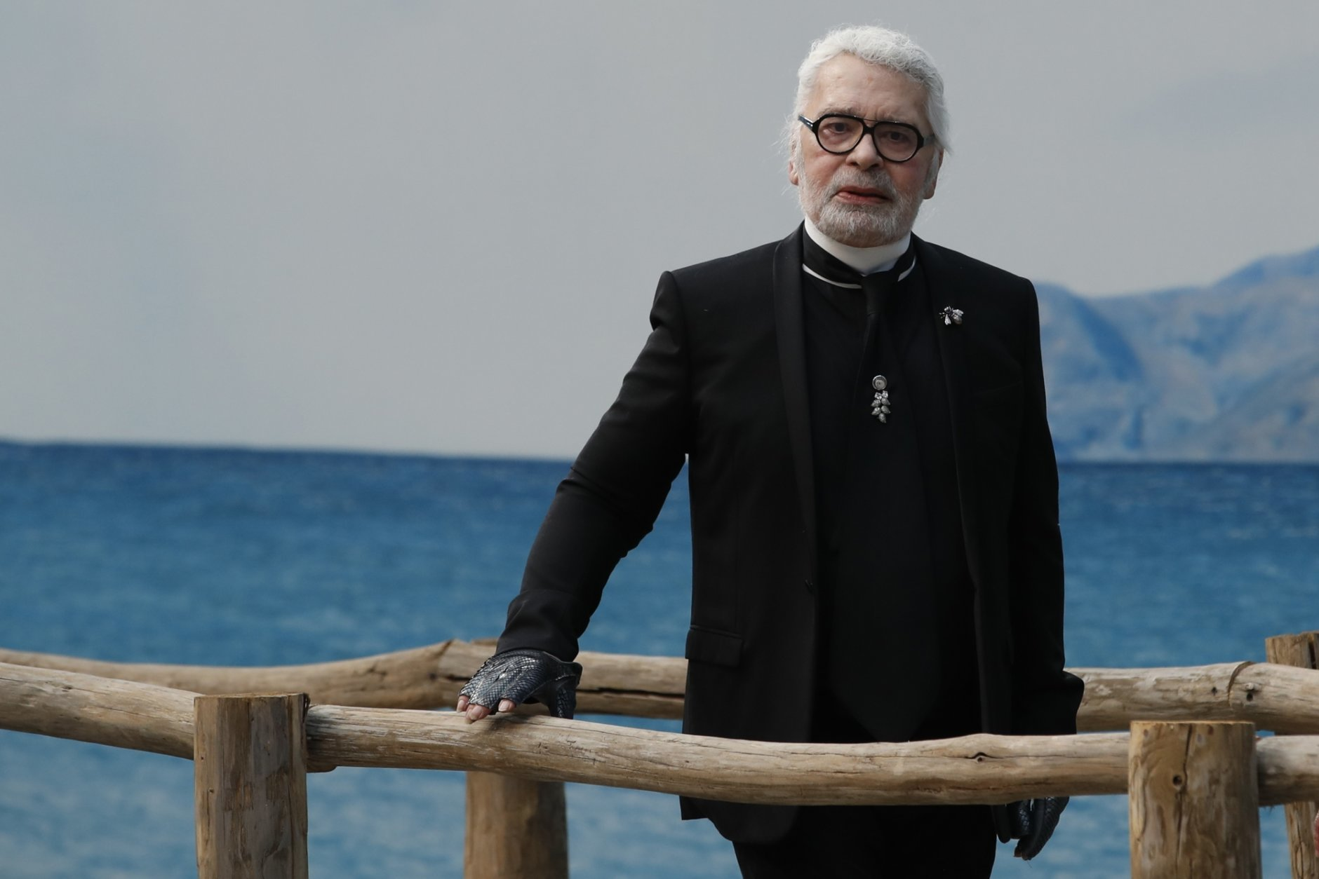 FILE  - In this Tuesday, Oct.2, 2018 file photo, fashion designer Karl Lagerfeld poses after the presentation of Chanel Spring/Summer 2019 ready-to-wear fashion collection in Paris, Tuesday, Oct.2, 2018. Chanel's iconic couturier, Karl Lagerfeld, whose accomplished designs as well as trademark white ponytail, high starched collars and dark enigmatic glasses dominated high fashion for the last 50 years, has died. He was around 85 years old. (AP Photo/Christophe Ena)
