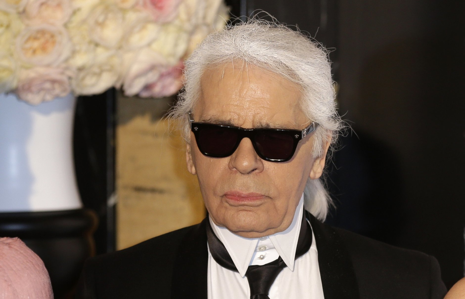 FILE - In this Saturday, March 28, 2015 file photo, Karl Lagerfeld poses for photographers as he arrives at the Rose Ball in Monaco. The Rose Ball is the traditional annual charity event in the Principality of Monaco. Chanel's iconic couturier, Karl Lagerfeld, whose accomplished designs as well as trademark white ponytail, high starched collars and dark enigmatic glasses dominated high fashion for the last 50 years, has died. He was around 85 years old. (AP Photo/Lionel Cironneau, File)