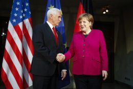 German Chancellor Angela Merkel, right, welcomes United States Vice President Mike Pence, left, for a bilateral meeting during the Munich Security Conference in Munich, Germany, Saturday, Feb. 16, 2019. (AP Photo/Matthias Schrader)