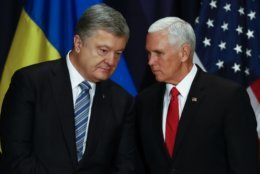 United States Vice President Mike Pence, right, talks with Ukrainian President Petro Poroshenko, left, during a bilateral meeting at the Munich Security Conference in Munich, Germany, Saturday, Feb. 16, 2019. (AP Photo/Matthias Schrader)