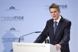 Great Britain's Secretary of State for Defence Gavin Williamson talks at the Munich Security Conference in Munich, Germany, Friday, Feb. 15, 2019. (Tobias Hase/dpa via AP)