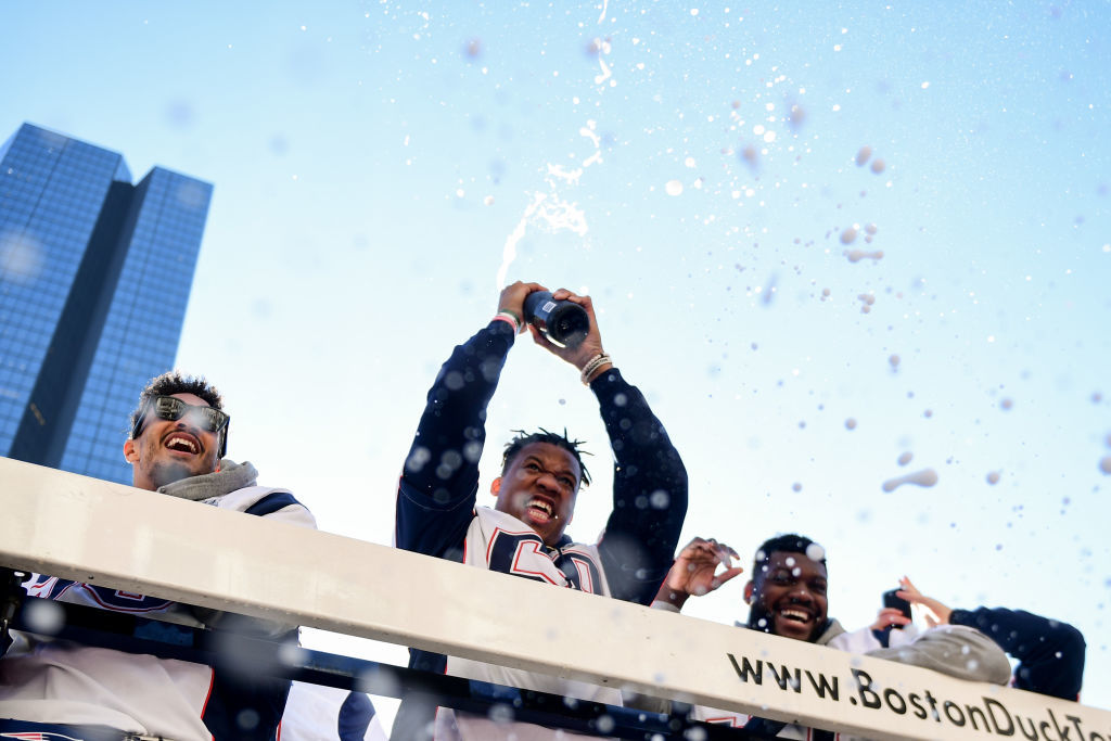 BOSTON, MASSACHUSETTS - FEBRUARY 05: Members of the New England Patriots celebrate during the Super Bowl Victory Parade on February 05, 2019 in Boston, Massachusetts. (Photo by Billie Weiss/Getty Images)