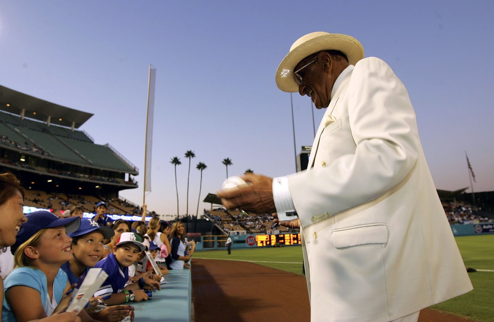 LOS ANGELES, CA - SEPTEMBER 01:   Hall of Famer and former Dodger pitcher Don Newcombe signs autographsbefore the game between the Los Angeles Dodgers on September 1, 2006 at Dodger Stadium in Los Angeles, California.  (Photo by Stephen Dunn/Getty Images)