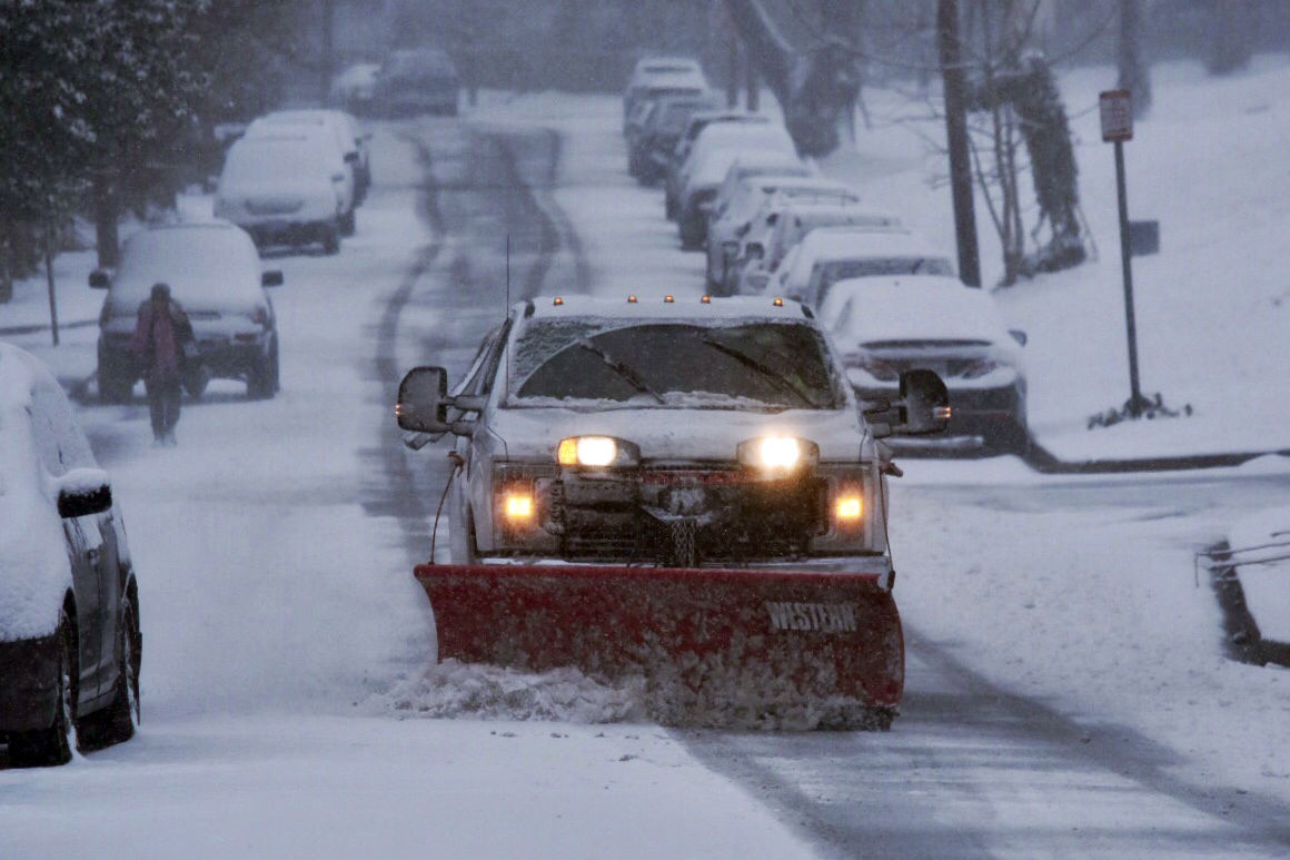 A plow hits the road in the District. (WTOP/Dave Dildine)