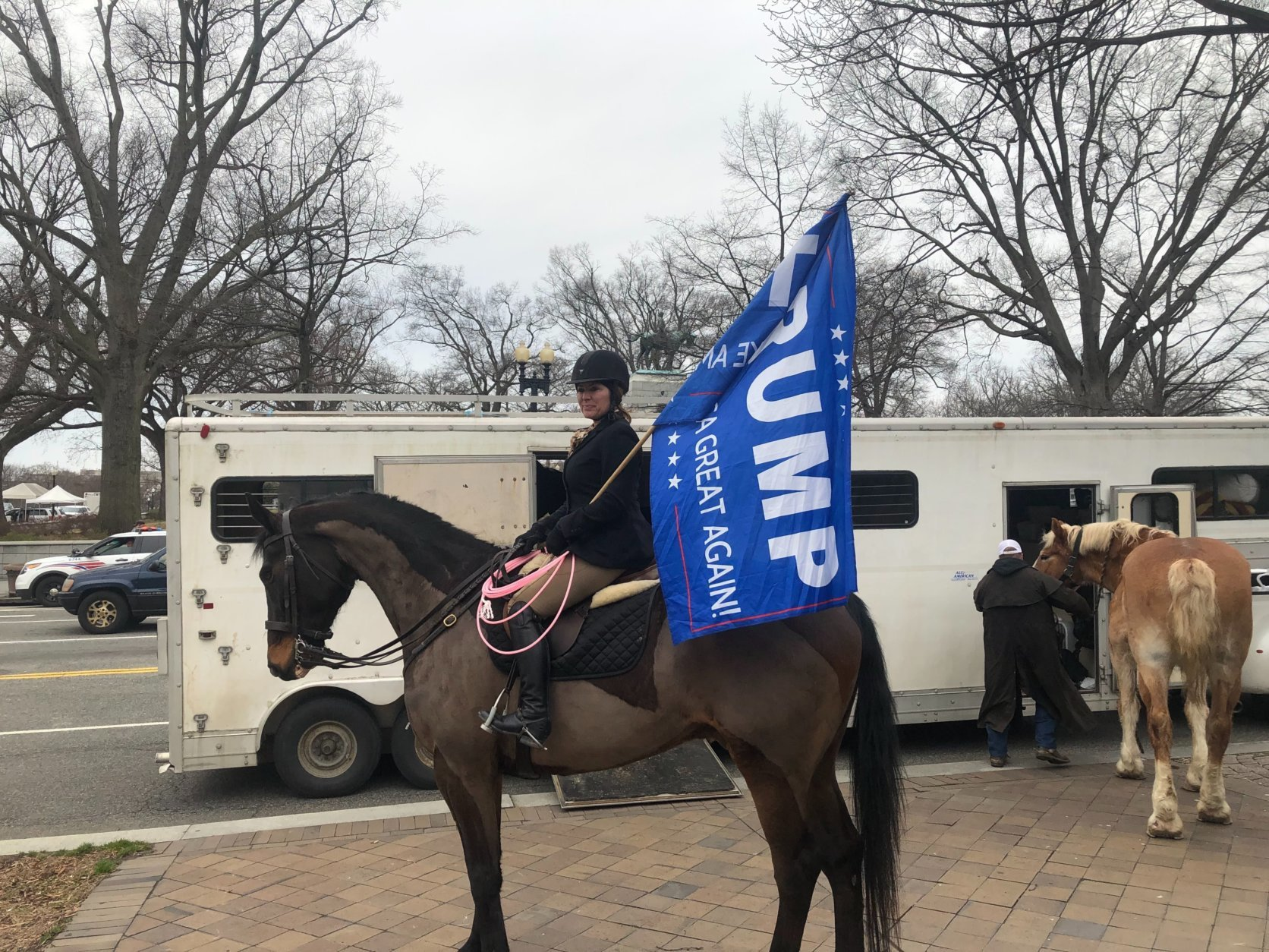 "Two dozen ""Cowboys for Trump"" made their way into the District on Friday with a police escort. (WTOP/Mike Murillo)"