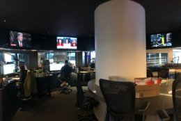 A panoramic view of editing stations in the middle of the WTOP newsroom. (WTOP/Sarah Beth Hensley)