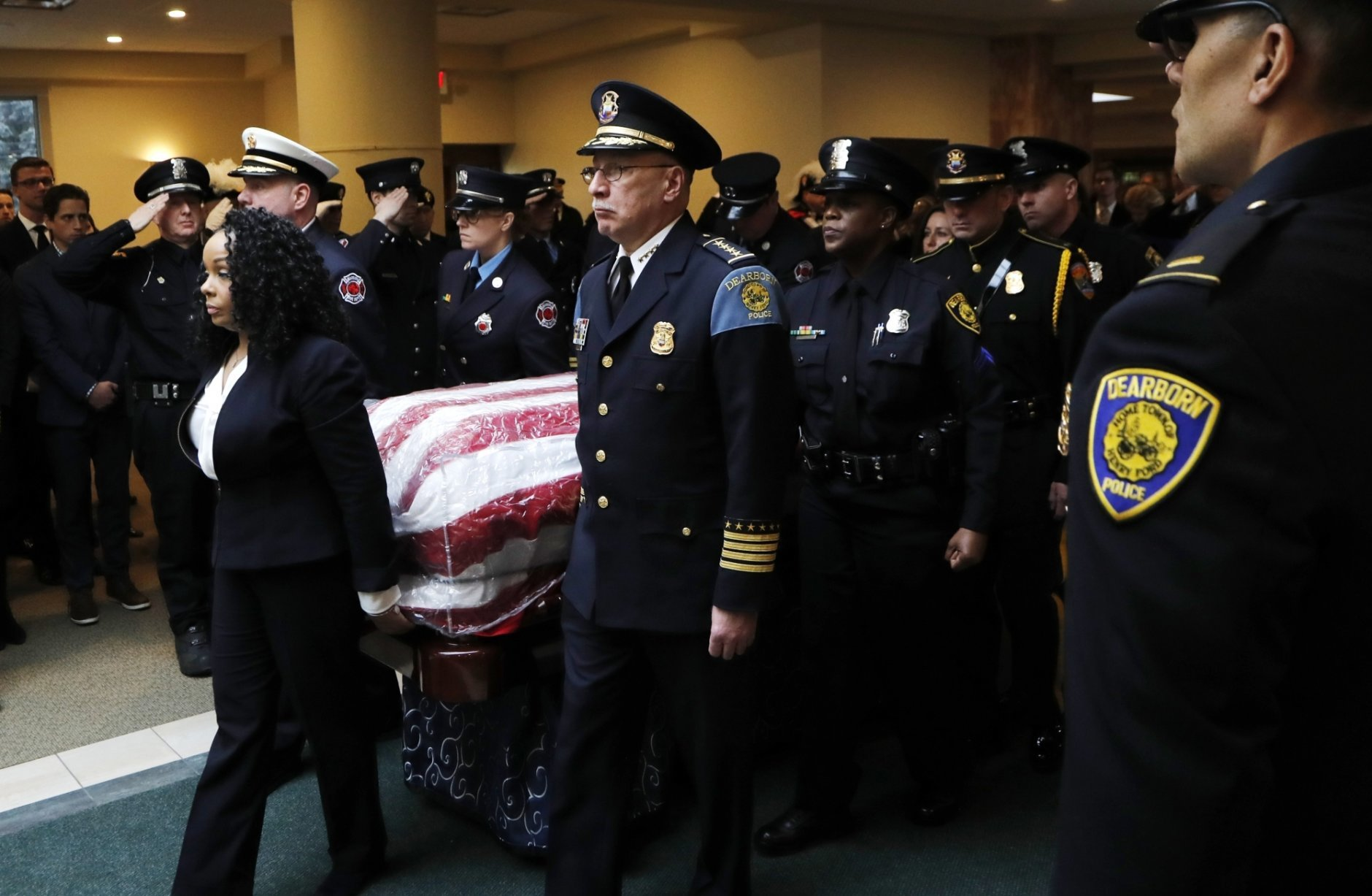 Dearborn, Mich., police and firefighter pallbearers carry the casket of former Rep. John Dingell, D-Mich. at the Church of the Divine Child, Tuesday, Feb. 12, 2019, in Dearborn, Mich. Dingell, the longest-serving member of Congress in American history, was first elected in 1955 and retired in 2014. (AP Photo/Carlos Osorio)