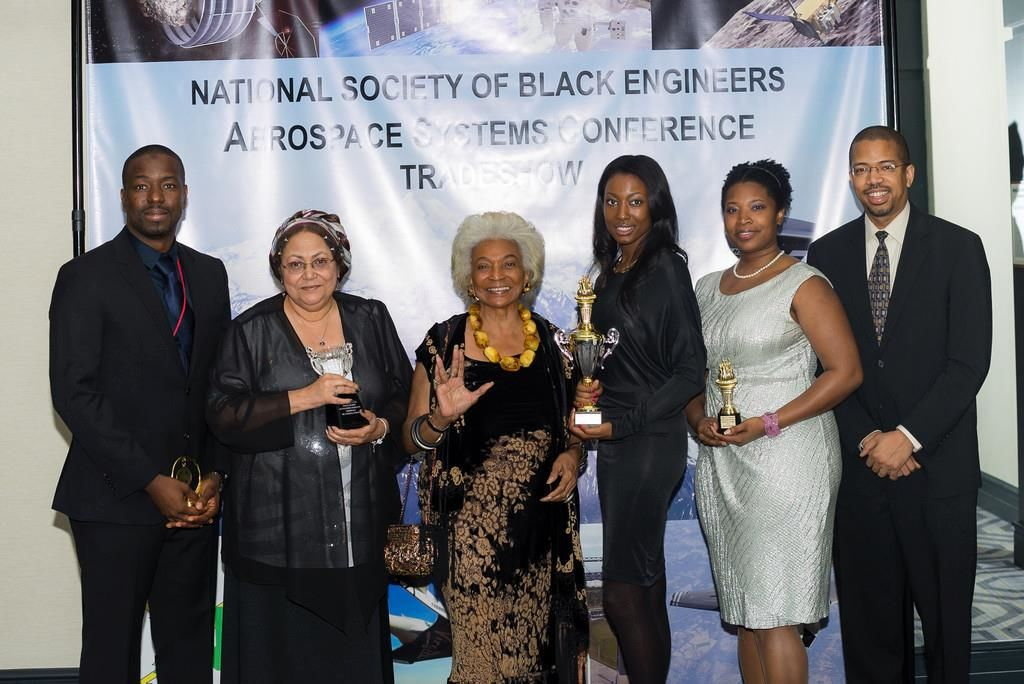 Aisha Bowe (third from right) poses with Nichelle Nichols (third from left), the iconic actress who played Lt. Uhura in the original Star Trek television series. (Courtesy Aisha Bowe)