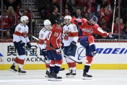 Washington Capitals right wing Brett Connolly (10) celebrates his goal with defenseman Christian Djoos (29), of Sweden, as Florida Panthers center Frank Vatrano (72), defenseman Ian McCoshen (12) and left wing Jonathan Huberdeau (11) stands on the ice during the second period of an NHL hockey game, Saturday, Feb. 9, 2019, in Washington. (AP Photo/Nick Wass)