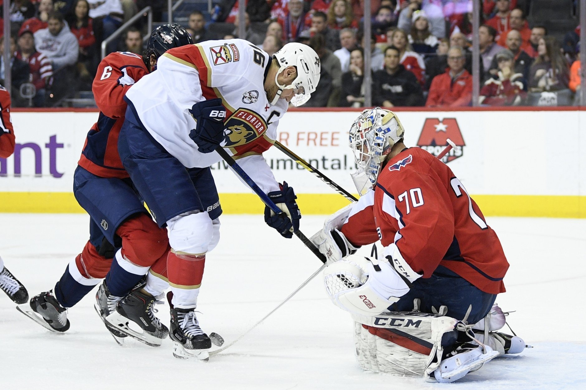 Florida Panthers center Aleksander Barkov (16), of Finland, battles for the puck against Washington Capitals goaltender Braden Holtby (70) during the second period of an NHL hockey game, Saturday, Feb. 9, 2019, in Washington. Also seen is Capitals defenseman Michal Kempny (6). (AP Photo/Nick Wass)