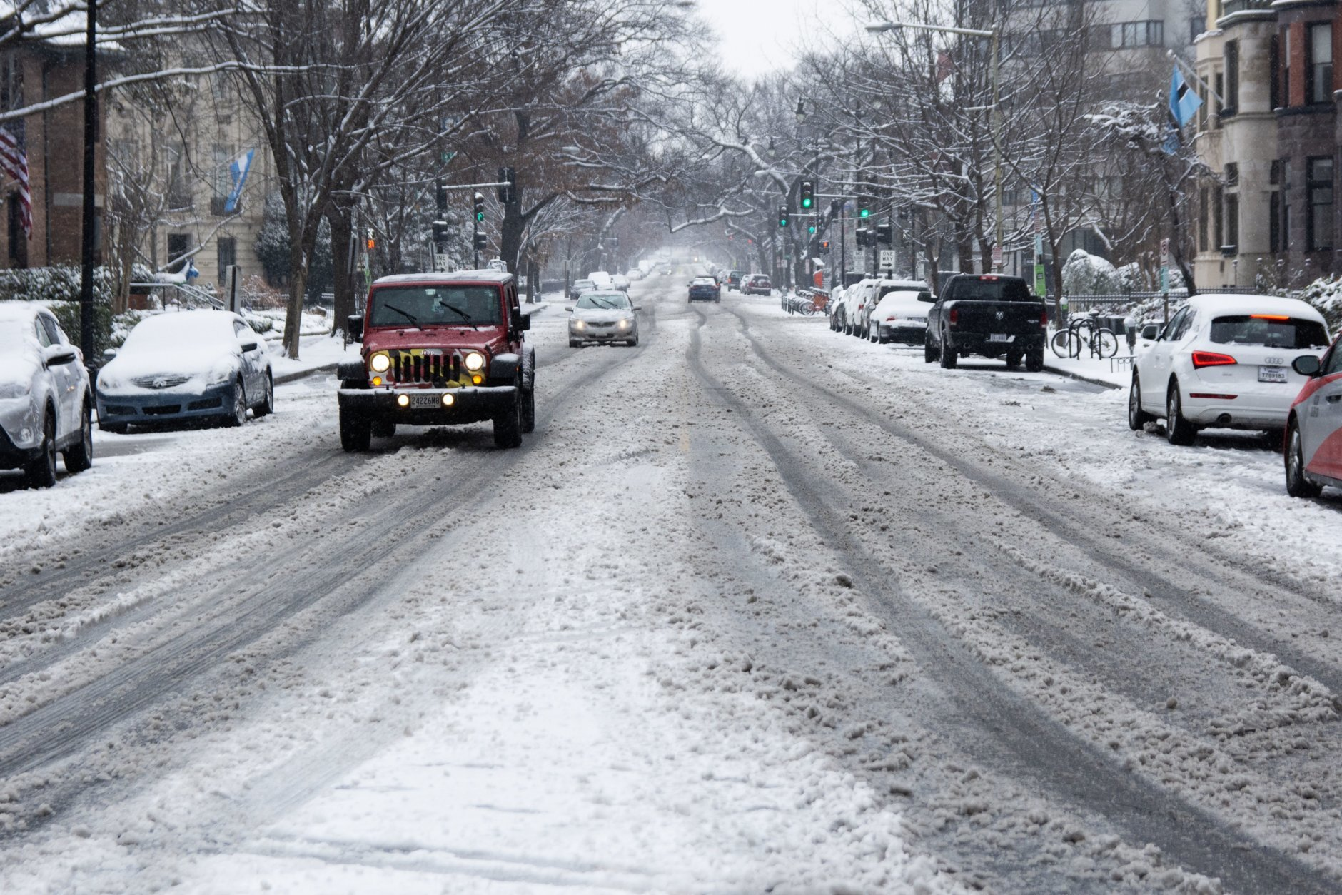 By noon Wednesday, rain and sleet had mixed in with snow — and slushy messes like this, near Dupont Circle, were common in downtown D.C. (WTOP/Alejandro Alvarez)