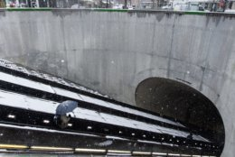 Snow-covered escalators leading into the Dupont Circle Metro Station. (WTOP/Alejandro Alvarez)