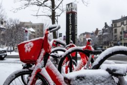 A Jump bikeshare outside the Dupont Circle Metro Station. Despite the snow, some people were seen using bikes on the sidewalk. (WTOP/Alejandro Alvarez)