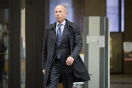 Attorney Michael Avenatti, who is representing an alleged victim of R. Kelly, walks into the Leighton Criminal Courthouse for R. Kelly's first hearing since the R&B star was charged with sexually abusing four people, including three minors, years ago, Saturday, Feb. 23, 2019 in Chicago.   Cook County Judge John Fitzgerald Lyke Jr. has set Kelly's bond at $1 million saying that the amount equals $250,000 for each of the four people he's charged with sexually abusing.    (Ashlee Rezin/Chicago Sun-Times via AP)