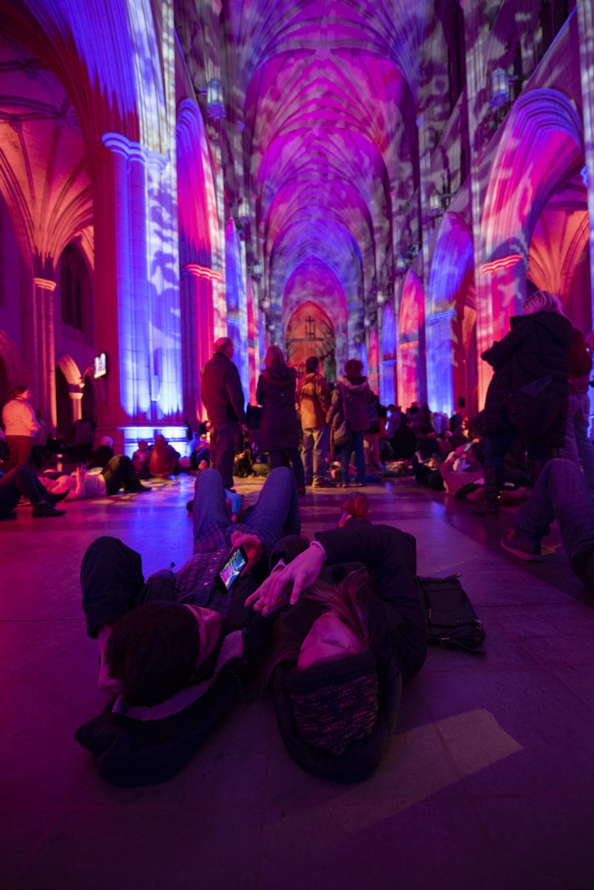 """As part of """"Space, Light and Sound"""" visitors Monday night were allowed to wander through the cathedral's vast gothic interior. (Courtesy Washington National Cathedral/Danielle E. Thomas)"""